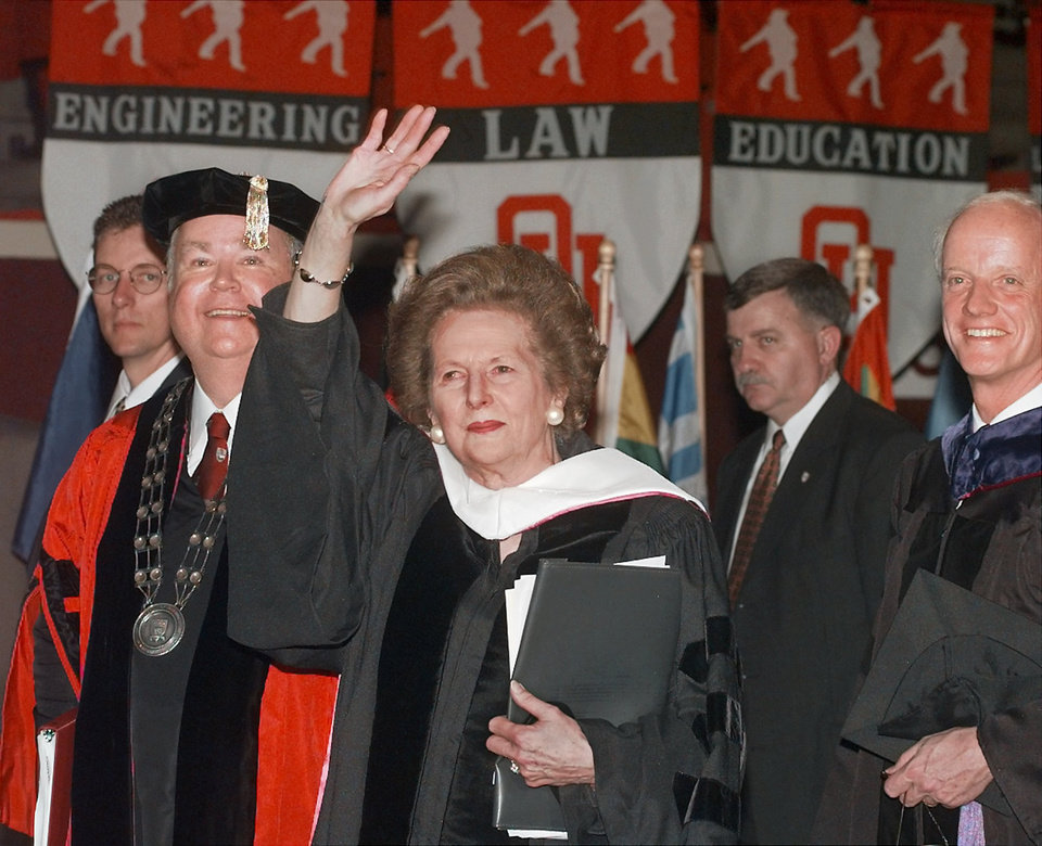 Photo - Margaret Thatcher waves to audience as she leaves the platform after delivering the keynote address to the academic convocation inside the Lloyd Noble Center Thursday afternoon.  Accompanying the former British prime minister is OU President David Boren, left, and Oklahoma Governor Frank Keating.