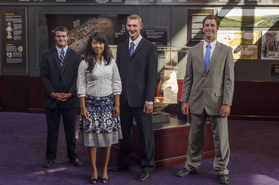 Photo - Herbert W. Armstrong College sudents Bailey Crawford, Monica Antonio, Tyrel Schlote and Callum Wood pose at the Seals of Jeremiah Captors Discovered exhibit in Armstrong Auditorium.  Wik Heerma - Herbert W. Armstrong College