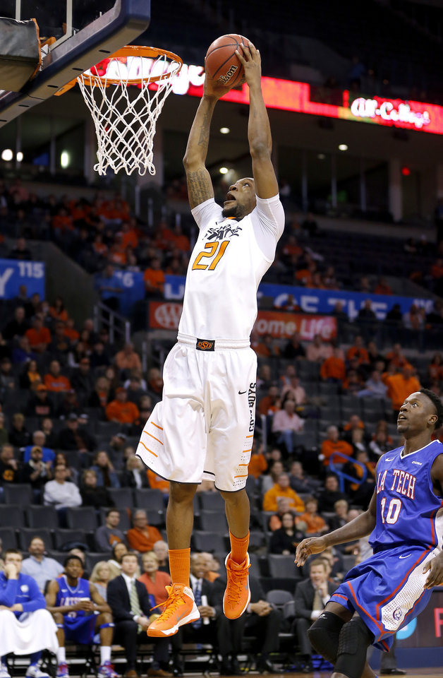 Oklahoma State's Kamari Murphy (21) dunks the ball in front of Louisiana Tech's Isaiah Massey (10) during the All-College Classic basketball game between Oklahoma State University and Louisiana Tech at Chesapeake Energy Arena in Oklahoma City, Okla., Saturday, Dec. 14, 2013. Photo by Bryan Terry, The Oklahoman