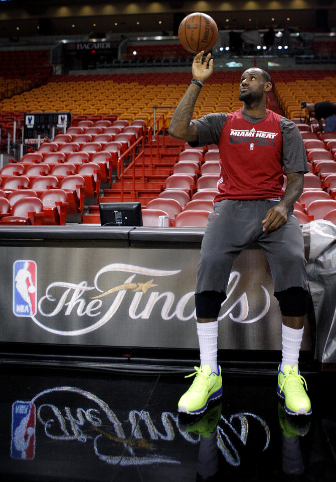 Miami\'s LeBron James spins the ball on his finger during a practice before Game 4 of the NBA Finals between the Oklahoma City Thunder and the Miami Heat at American Airlines Arena, Monday, June 18, 2012. Photo by Bryan Terry, The Oklahoman