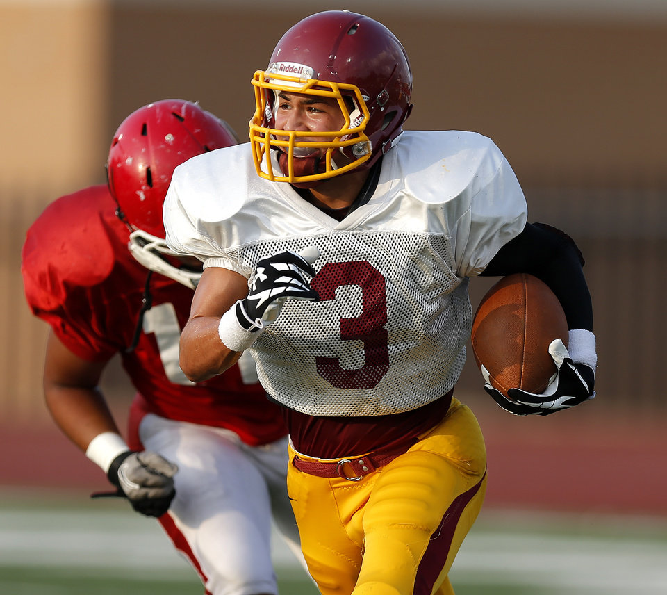 Photo - Putnam City North's Alex Clark runs after an interception during a football scrimmage against Lawton at Putnam City High School in Warr Acres, Okla., Thursday, August 16, 2012. Photo by Bryan Terry, The Oklahoman