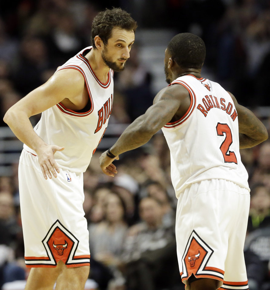 Chicago Bulls Marco Belinelli, left, of Italy, celebrates with Nate Robinson after scoring a three-point shot during the second half of an NBA basketball game against the Washington Wizards in Chicago on Saturday, Dec. 29, 2012. The Bulls won 87-77. (AP Photo/Nam Y. Huh)