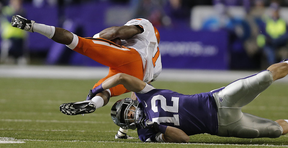 Kansas State\'s Ty Zimmerman (12) stops Oklahoma State\'s Joseph Randle (1) during the college football game between the Oklahoma State University Cowboys (OSU) and the Kansas State University Wildcats (KSU) at Bill Snyder Family Football Stadium on Saturday, Nov. 1, 2012, in Manhattan, Kan. Photo by Chris Landsberger, The Oklahoman