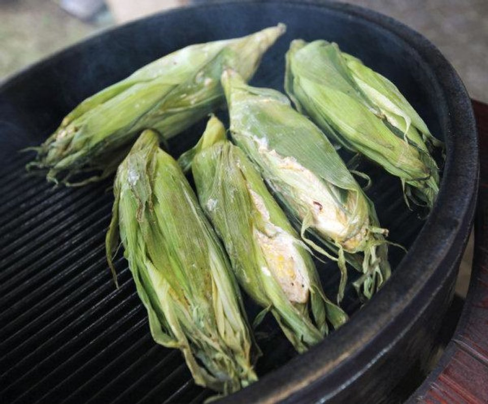 Photo - Corn cooks on a grill during a cooking event at American Propane, 7401 Broadway Extension. Photo by Nate Billings, The Oklahoman  NATE BILLINGS