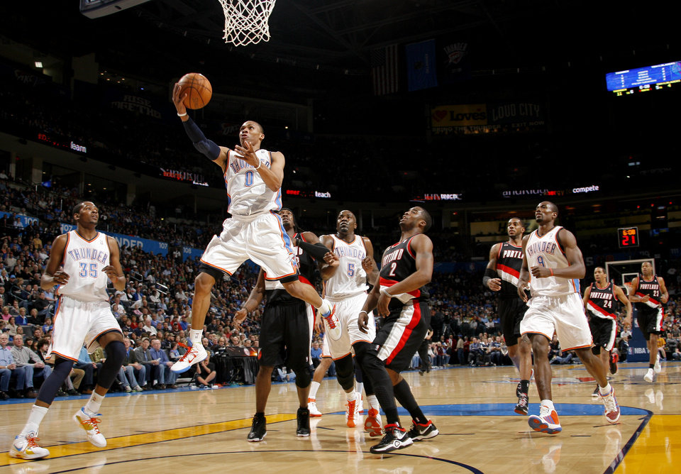 Photo - Oklahoma City's Russell Westbrook (0) shoots a layup during the NBA basketball game between the Oklahoma City Thunder and the Portland Trailblazers, Sunday, March 27, 2011, at the Oklahoma City Arena. Photo by Sarah Phipps, The Oklahoman