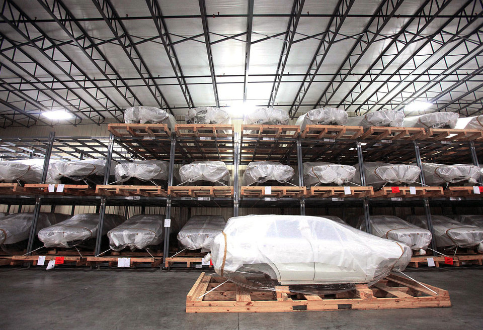 Mercedes SUV bodies are seen during a tour of the SKD packaging facility at BLG Logistics Inc. in Vance, Ala. AP Photo