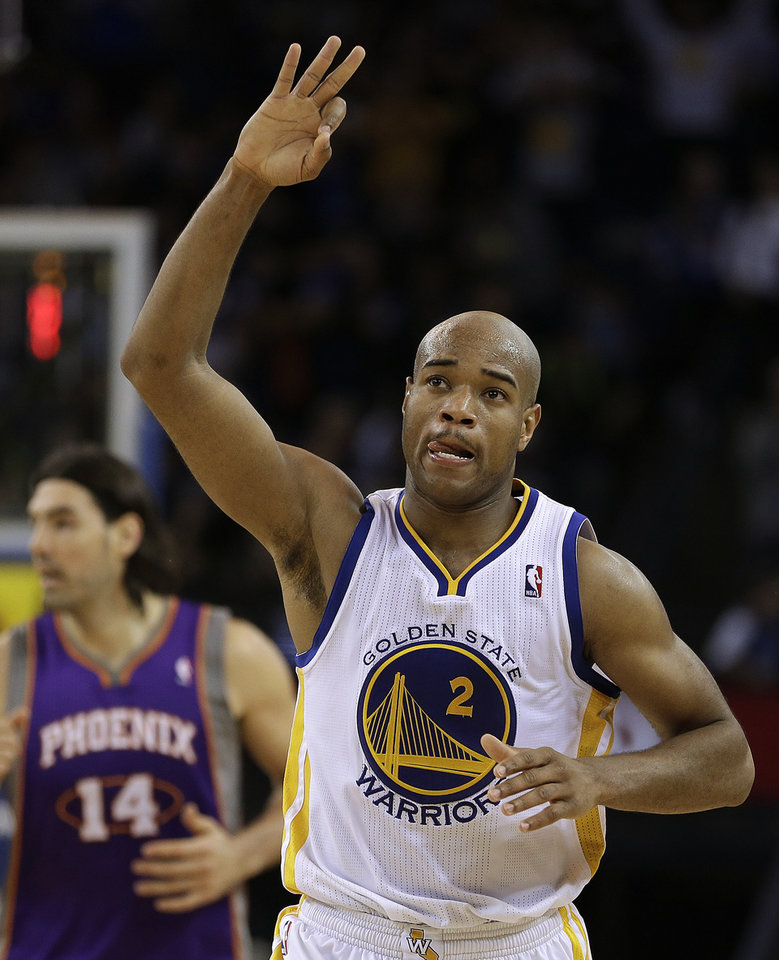 Golden State Warriors' Jarrett Jack celebrates his score against the Phoenix Suns during the second half of an NBA basketball game Wednesday, Feb. 20, 2013, in Oakland, Calif. (AP Photo/Ben Margot)