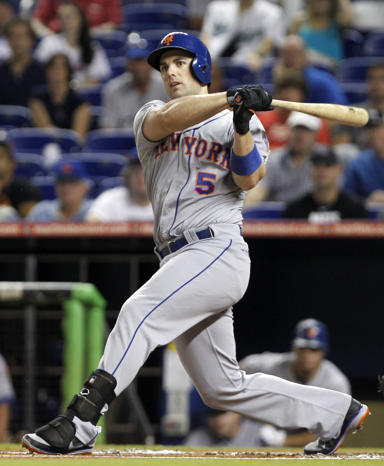 Photo - FILE - In this Oct. 2, 2012 file photo, New York Mets' David Wright follows through  against the Miami Marlins during a baseball game in Miami. WFAN radio is reporting Friday, Nov. 30, 2012, that Wright and the New York Mets have agreed to a $138 million, eight-year contract that would be the richest in franchise history. (AP Photo/Alan Diaz, File)