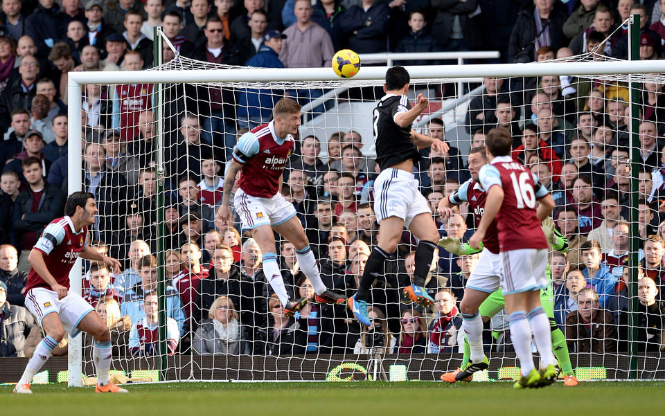 Photo - Southampton's Maya Yoshida, centre,  scores his side's first goal of the game, during the English Premier League match against West Ham, at Upton Park, London, Saturday Feb.  22, 2014. (AP Photo/PA, Anthony Devlin) UNITED KINGDOM OUT: NO SALES: NO ARCHIVE