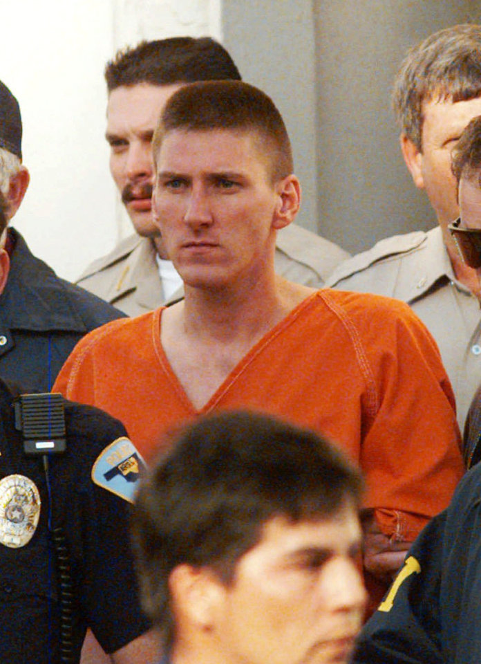 FILE  This  Friday, April 21, 1995 file photo shows Oklahoma City bombing suspect Timothy McVeigh escorted by law enforcement officials from the Noble County Courthouse in Perry, Oklahoma. Mass murderer Anders Behring Breivik's shocking testimony to a Norwegian court has revived a debate about how much of a public platform mass-murderers should be given in trials. Such atrocities are often waged for attention and carried out in the name of political or religious goals, and a trial gives perpetrators more of what they crave: a huge audience. Perhaps ironically, some extremists who carry out horrific attacks to make a political point reject the opportunity to speak out in court. An example is Timothy McVeigh, who acted out of hatred for the U.S. government when he bombed a federal building in Oklahoma City in 1995, killing 168 people.(AP Photo/David Longstreath, File) ORG XMIT: LON116