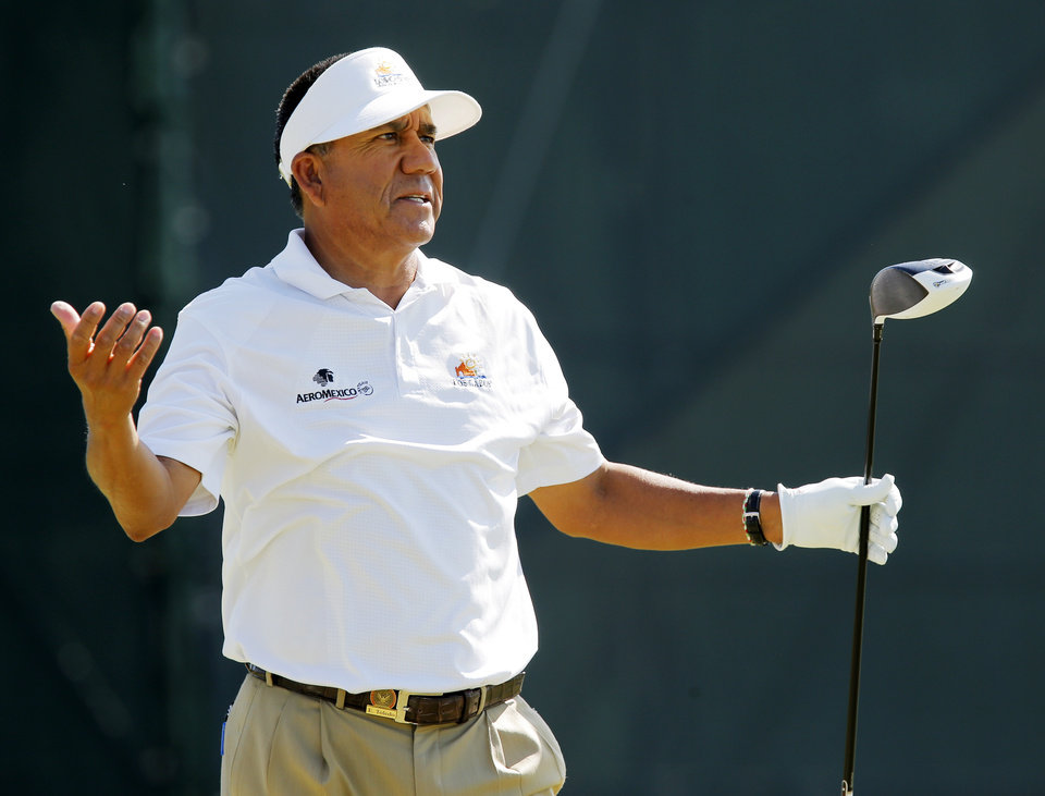 Photo - Esteban Toledo reacts to a tee shot on No. 18 during practice rounds for the U.S. Senior Open golf tournament at Oak Tree National in Edmond, Okla., Monday, July 7, 2014. Photo by Nate Billings, The Oklahoman
