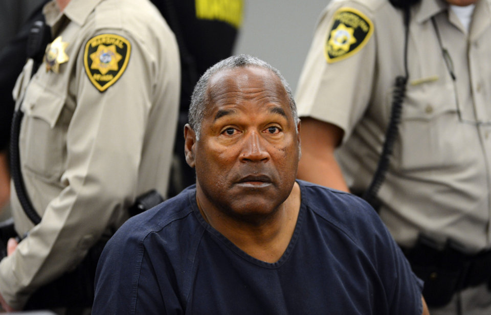 Photo - O.J. Simpson sits during a break appears during a break on the second day of  an evidentiary hearing in Clark County District Court, Tuesday, May 14, 2013 in Las Vegas.  The hearing is aimed at proving Simpson's trial lawyer, Yale Galanter,  had conflicted interests and shouldn't have handled Simpson's case. Simpson is serving nine to 33 years in prison for his 2008 conviction in the armed robbery of two sports memorabilia dealers in a Las Vegas hotel room. (AP Photo/Ethan Miller, Pool)