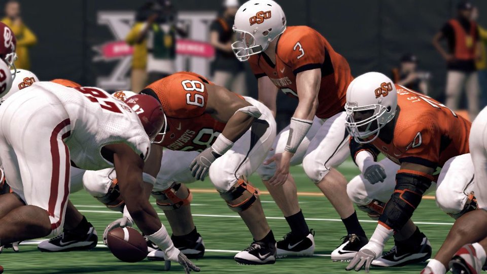 Photo - Oklahoma State quarterback Brandon Weeden under center in the new NCAA Football 11 game from EA Sports. PHOTO PROVIDED