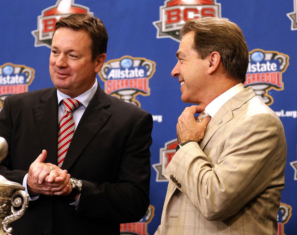 Oklahoma head coach Bob Stoops and Alabama head coach Nick Saban greet each other during a press conference for the Allstate Sugar Bowl, Wednesday, Jan. 1, 2014 in New Orleans. Photo by Sarah Phipps, The Oklahoman