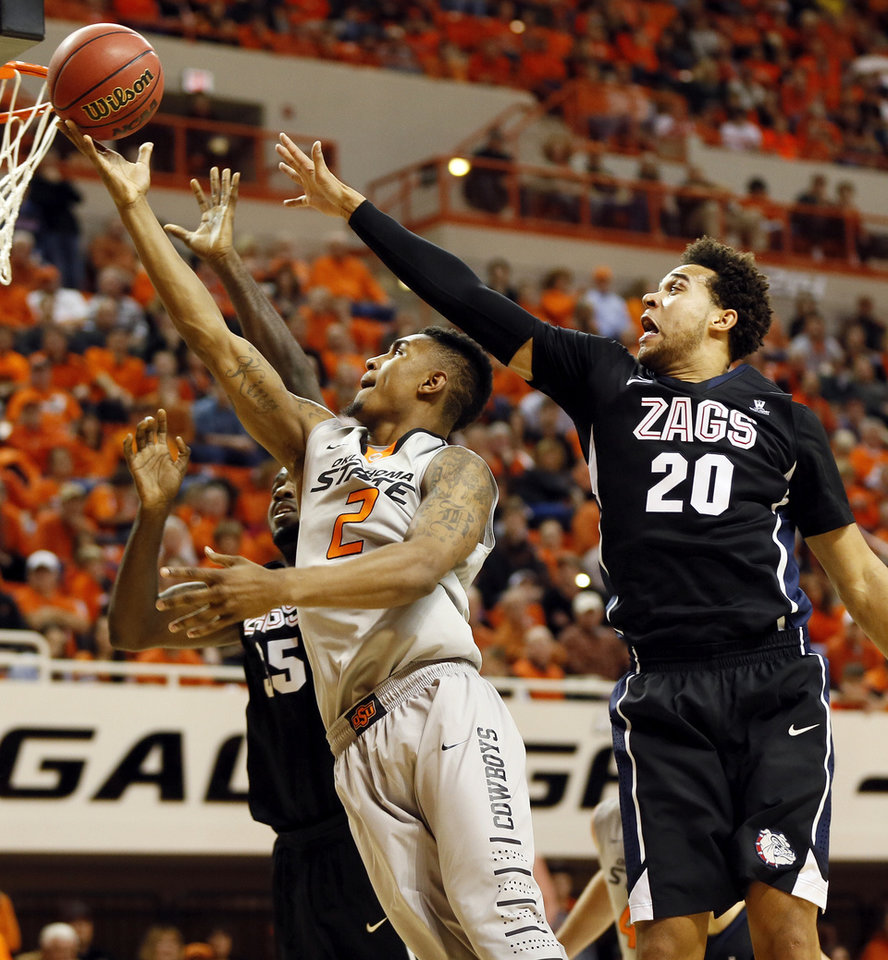 Photo - Oklahoma State's Le'Bryan Nash (2) lays up the ball between Gonzaga's Elias Harris (20) and Sam Dower (35) during a men's college basketball game between Oklahoma State University (OSU) and Gonzaga at Gallagher-Iba Arena in Stillwater, Okla., Monday, Dec. 31, 2012. Photo by Nate Billings, The Oklahoman