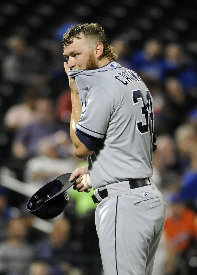 Photo - San Diego Padres starting pitcher Andrew Cashner (34) reacts after walking New York Mets' Taylor Teagarden in the fourth inning of a baseball game at Citi Field on Friday, June 13, 2014, in New York. (AP Photo/Kathy Kmonicek)