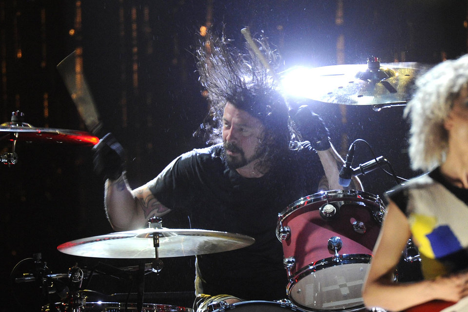 Photo - Hall of Fame Inductee, Nirvana, Dave Grohl performs at the 2014 Rock and Roll Hall of Fame Induction Ceremony on Thursday, April, 10, 2014 in New York. (Photo by Charles Sykes/Invision/AP)