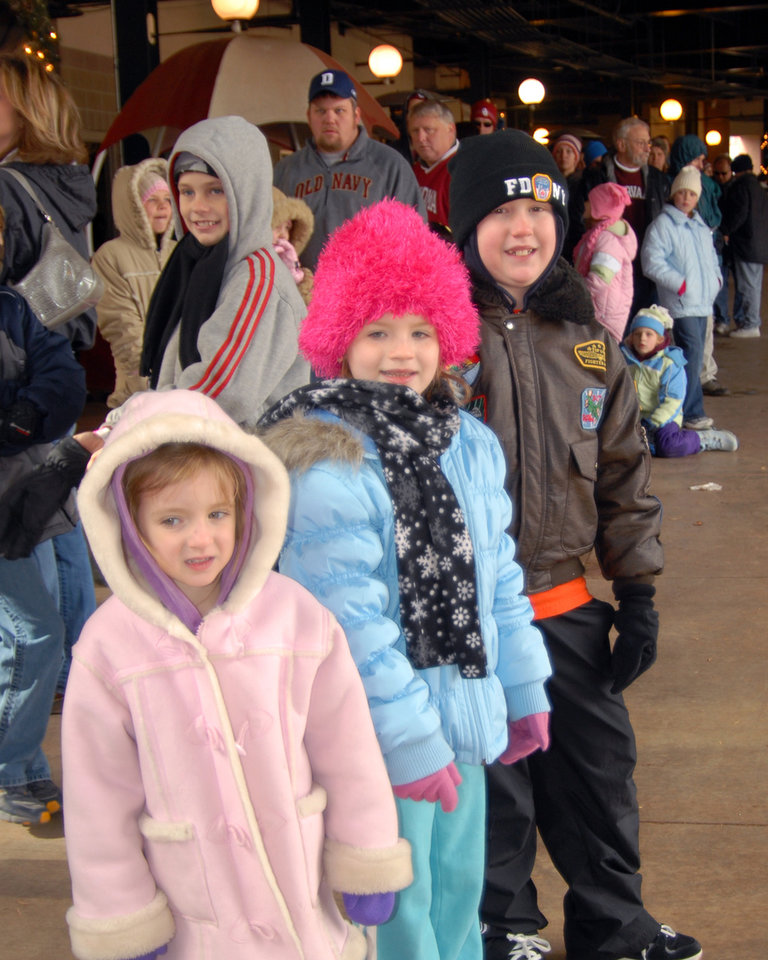 Molly Norton, age 4, Sophie Jordan, age 6, and Cade Norton, age 8 (my grandchildren) wait in line for snow tubing at AT&T Ballpark.<br/><b>Community Photo By:</b> Gina Jordan Kishr<br/><b>Submitted By:</b> Gina Jordan, Oklahoma City