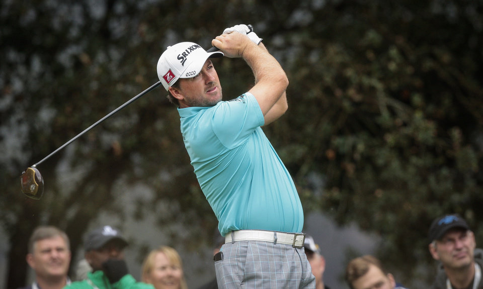 Photo - Graeme McDowell tees off on the second hole during the second round of the World Challenge golf tournament at Sherwood Country Club in Thousand Oaks, Calif., Friday, Nov. 30, 2012. (AP Photo/Bret Hartman)