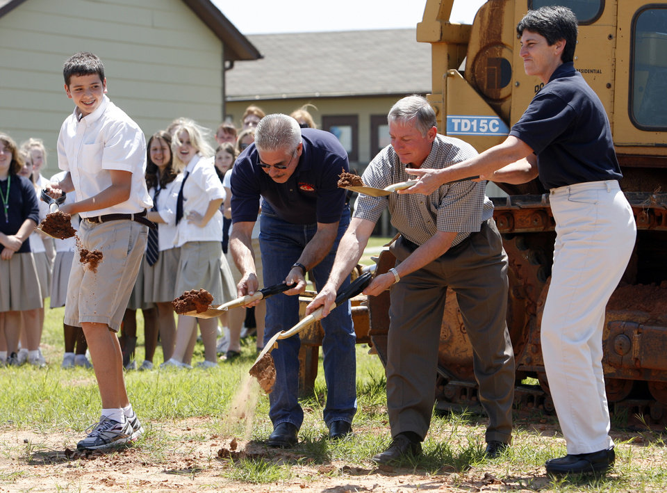Student Clayton Kinsey, builder Jerry Meek, and officials Greg Buwick and Leslie Schmitt break ground for a new gymnasium at All Saints Catholic School in Norman, Okla. on Wednesday, May 20, 2009 Photo by Steve Sisney, The Oklahoman