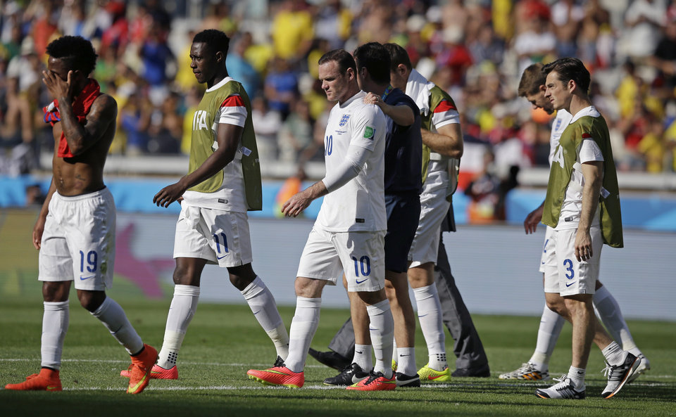 Photo - England's Wayne Rooney, centre, leaves the field after the group D World Cup soccer match between Costa Rica and England at the Mineirao Stadium in Belo Horizonte, Brazil, Tuesday, June 24, 2014. (AP Photo/Matt Dunham)