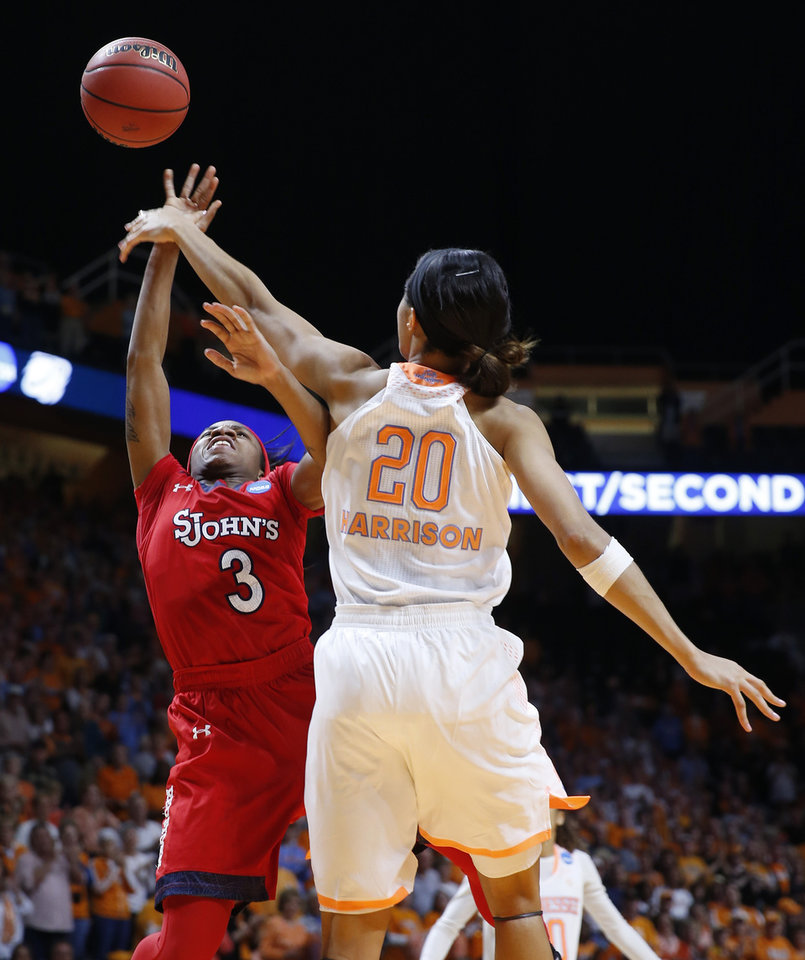 Photo - Tennessee center Isabelle Harrison (20) blocks a shot by St. John's guard Aliyyah Handford (3) in the second half of an NCAA women's college basketball second-round tournament game Monday, March 24, 2014, in Knoxville, Tenn. (AP Photo/John Bazemore)