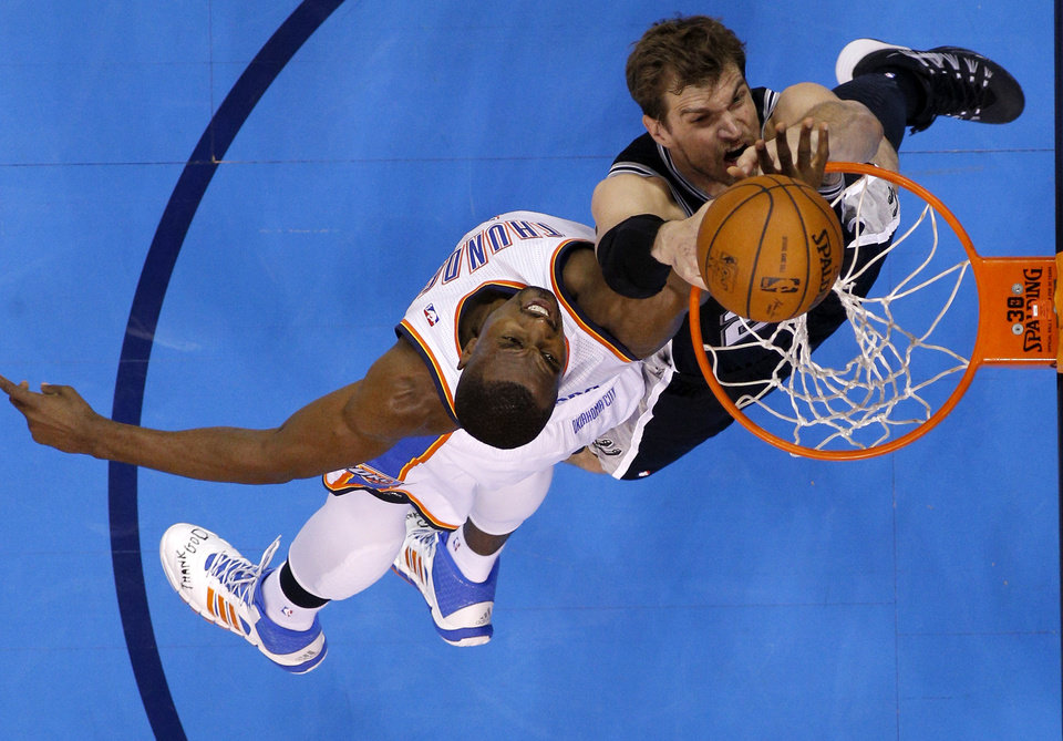 Photo - Oklahoma City's Serge Ibaka (9) defends San Antonio's Tiago Splitter (22) during Game 3 of the Western Conference Finals in the NBA playoffs between the Oklahoma City Thunder and the San Antonio Spurs at Chesapeake Energy Arena in Oklahoma City, Sunday, May 25, 2014. Photo by Bryan Terry, The Oklahoman