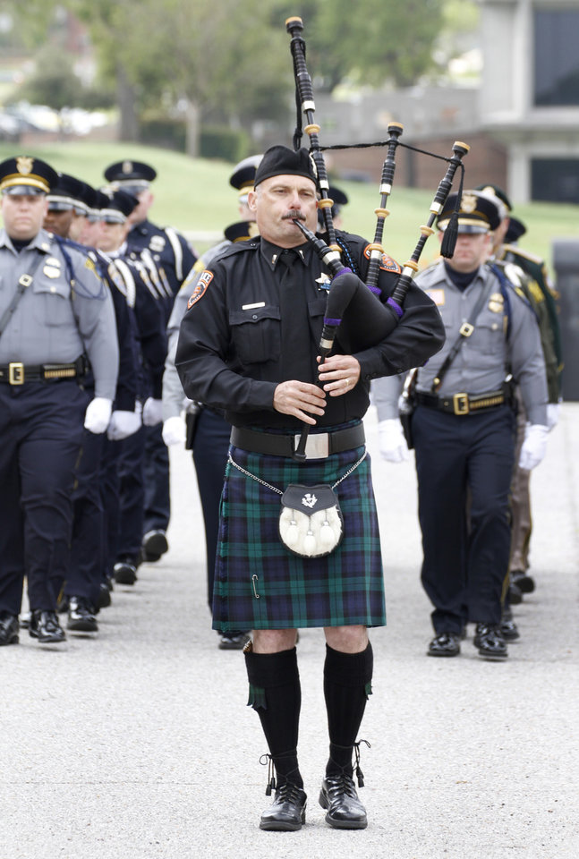 Lt. Curtis Burns, Oklahoma State University Police Department plays the bagpipes during the Entrance of Honor Guards during the Oklahoma Law Enforcement Officers Memorial Service in Oklahoma City , Friday May 10, 2013. Photo By Steve Gooch, The Oklahoman