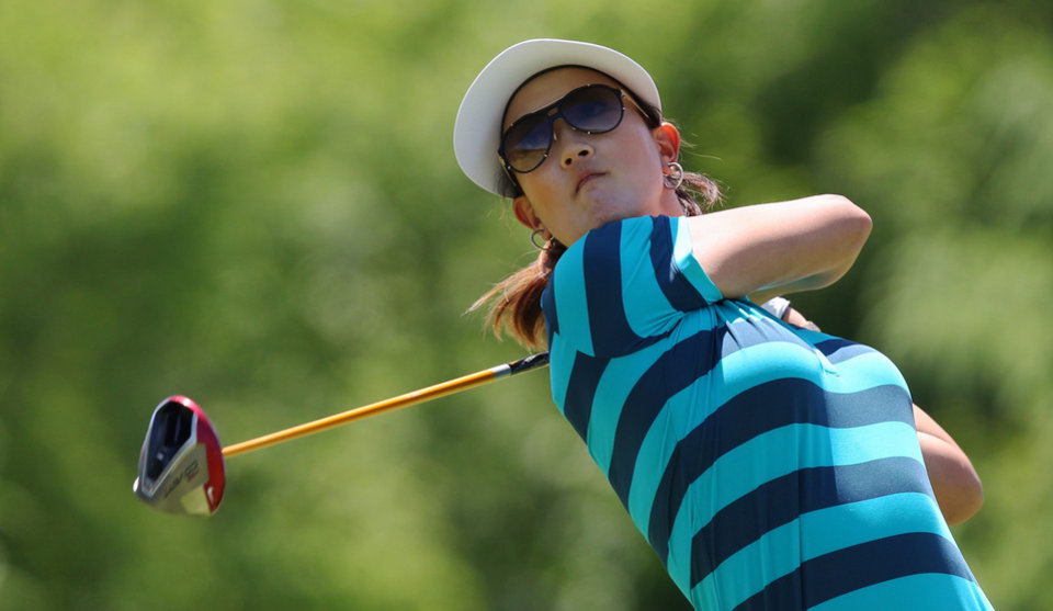 Photo - Michelle Wie watches her tee shot on the fifth hole during the third round of the Manulife Financial LPGA Classic golf tournament Saturday, June 7, 2014 in Waterloo, Ontario. (AP Photo/The Canadian Press, Dave Chidley)