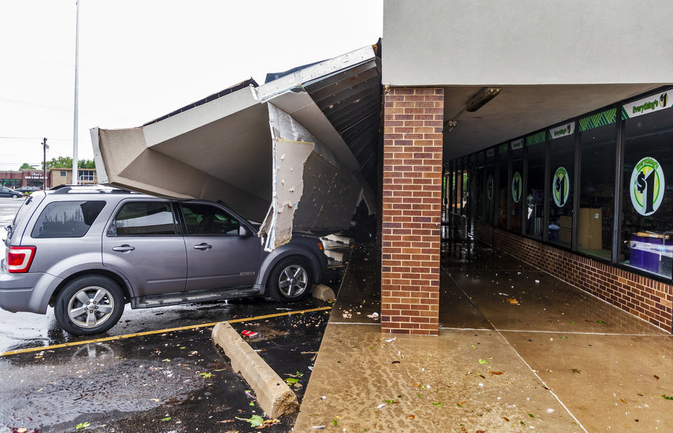 Photo - Storm damage to the Dollar Tree located off of SE 15th and Sunnylane in Del City, Okla. on Tuesday, Aug. 27, 2019.   [Chris Landsberger/The Oklahoman]