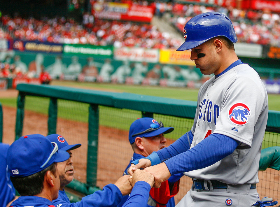 Photo - Chicago Cubs' Anthony Rizzo is congratulated after scoring on Junior Lake's sacrifice fly during the eighth inning of a baseball game against the St. Louis Cardinals on Thursday, May 15, 2014, in St. Louis. The Cardinals won 5-3. (AP Photo/Sarah Conard)