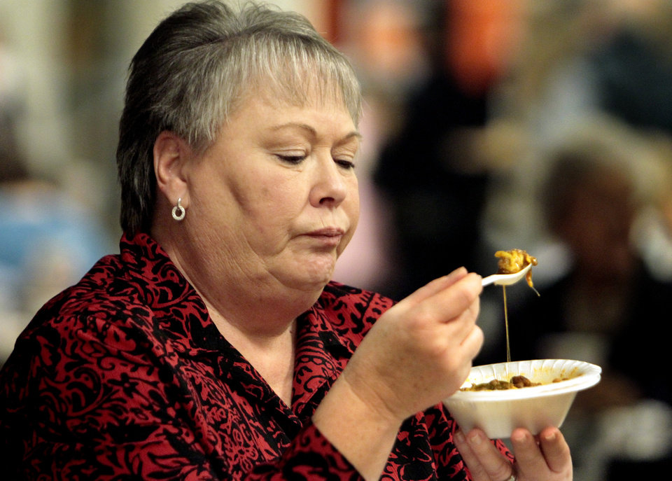 Kathy LaMar, assistant to the police chief, enjoys her bowl of chili with cheese during the 37th annual Police/Fire Chili Supper, benefiting the Cleveland County Christmas Store on Thursday, Jan. 10, 2013 in Norman, Okla.  Photo by Steve Sisney, The Oklahoman