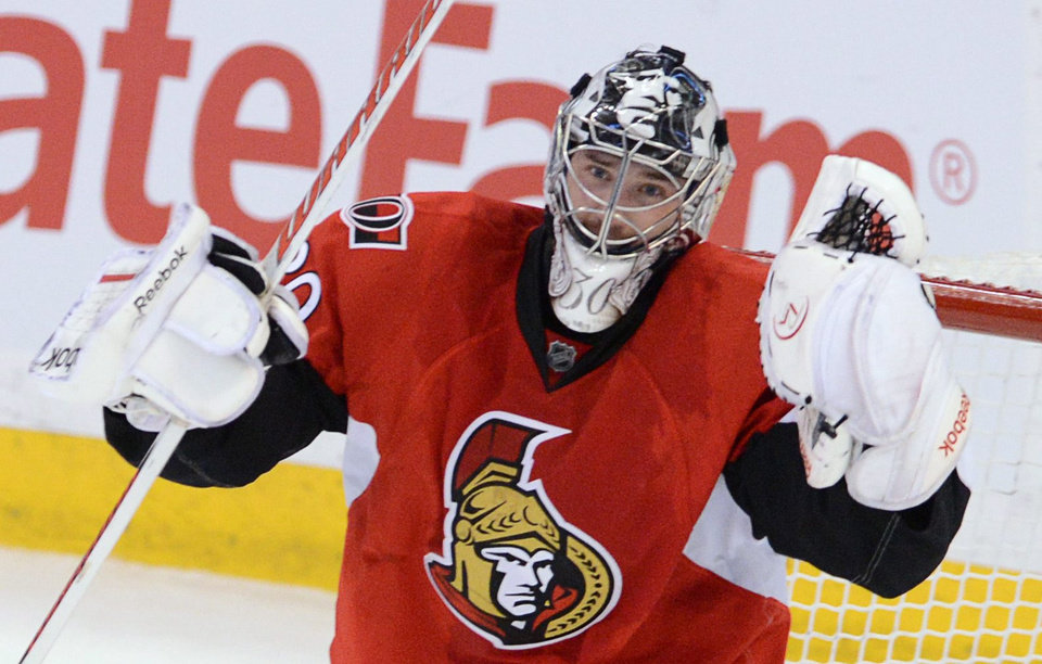 Ottawa Senators goaltender Ben Bishop celebrates their 2-1 shootout win over the Montreal Canadiens after their NHL hockey game, Monday, Feb. 25, 2013, in Ottawa, Ontario. (AP Photo/The Canadian Press, Sean Kilpatrick)