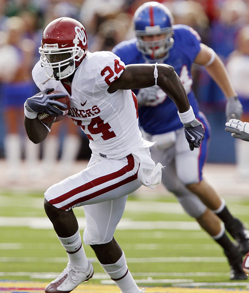 Photo - Oklahoma's Dejuan Miller (24) gets past the Kansas defense after a reception during the first half of the college football game between the University of Oklahoma Sooners (OU) and the University of Kansas Jayhawks (KU) on Saturday, Oct. 24, 2009, in Lawrence, Kan. Photo by Chris Landsberger, The Oklahoman