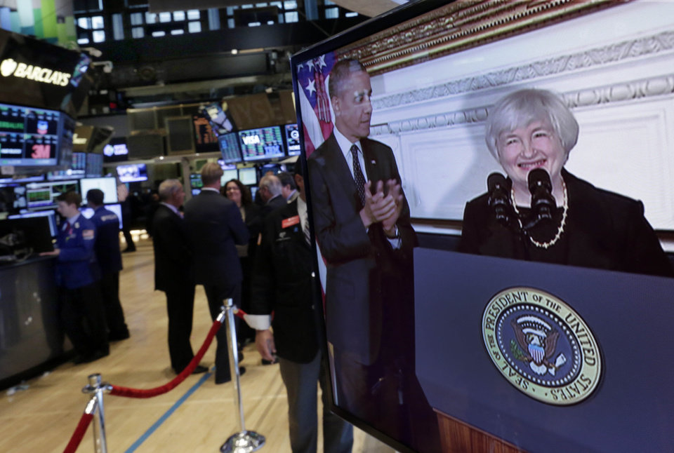 Photo - Federal Reserve Chair nominee Janet Yellen's introduction by President Barack Obama is shown on a television monitor on the trading floor of the New York Stock Exchange Wednesday, Oct. 9, 2013. President Obama says that in Janet Yellen he's found a tough and proven leader to take over as chairman of the Federal Reserve. (AP Photo/Richard Drew)