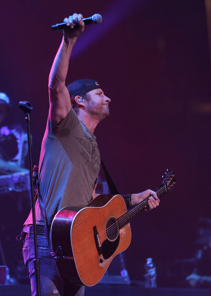 Dierks Bentley performs at the Chesapeake Energy Arena in Oklahoma City, Friday, March 8, 2013. He and tour mate Miranda Lambert, who lives in Tishomingo, will bring their ?Locked & Reloaded Tour? back to the Sooner State for an April 13 show at Tulsa's BOK Center.  Photo by Garett Fisbeck, For The Oklahoman <strong>Garett Fisbeck - FOR THE OKLAHOMAN</strong>