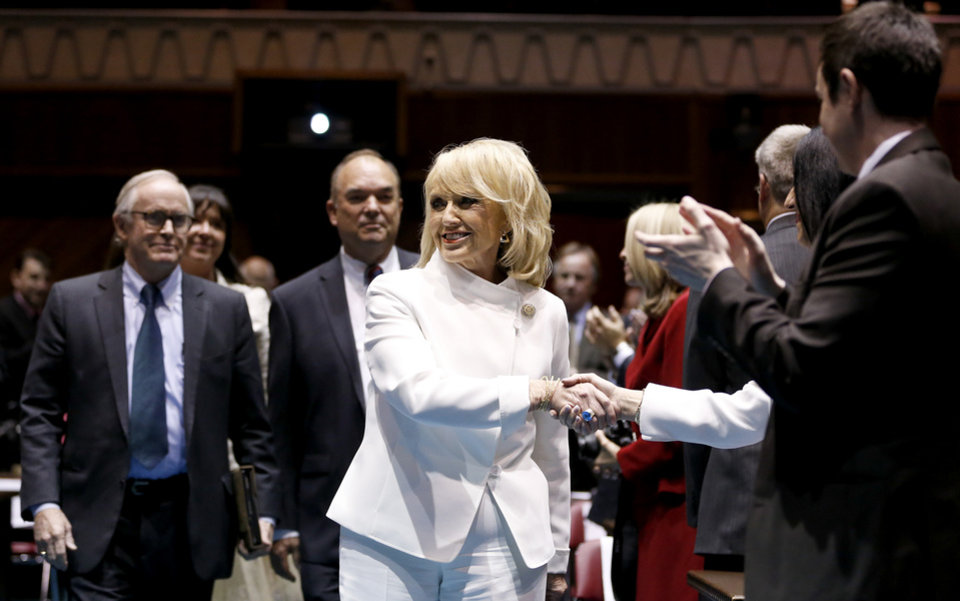 Arizona Gov. Jan Brewer arrives on the floor of the Arizona House of Representatives to give her State of the State speech at the Arizona Capitol, Monday, Jan. 14, 2013, in Phoenix.(AP Photo/Ross D. Franklin)