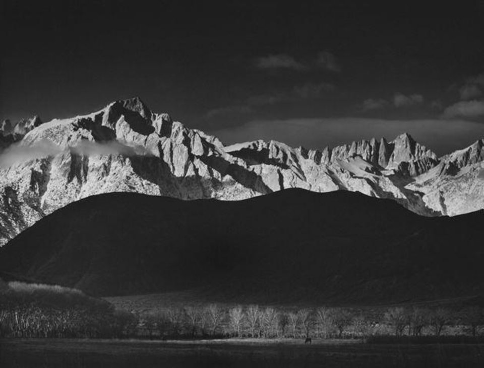 """Photo -  Ansel Adams' iconic photograph """"Winter Sunrise, Sierra Nevada From Lone Pine, California"""" is part of the exhibit """"Ansel Adams: An American Perspective"""" at the Oklahoma City Museum of Art. Photo provided"""