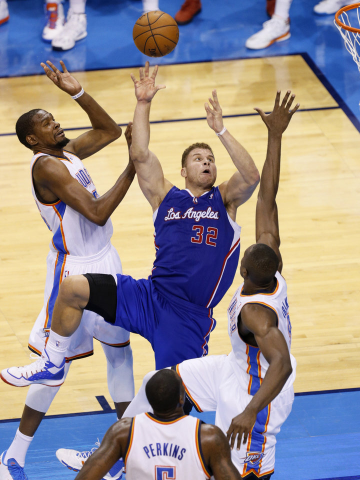 Photo - Los Angeles' Blake Griffin (32) shoots the ball from between Oklahoma City's Kevin Durant (35) and Serge Ibaka (9) during Game 5 of the Western Conference semifinals in the NBA playoffs between the Oklahoma City Thunder and the Los Angeles Clippers at Chesapeake Energy Arena in Oklahoma City, Tuesday, May 13, 2014. Photo by Bryan Terry, The Oklahoman