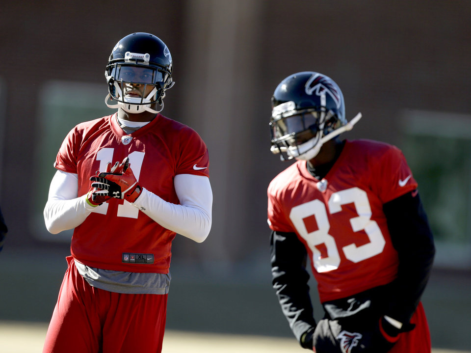 Atlanta Falcons' Julio Jones, left, stands on the field with teammate Harry Douglas during NFL football practice at the team's training facility, Friday, Jan. 18, 2013, in Flowery Branch, Ga. The Falcons host the San Francisco 49ers in the NFC championship on Sunday. (AP Photo/David Goldman)