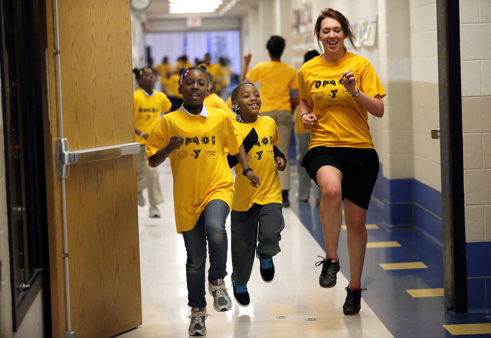 Elizabeth Smith,  right, runs with Donajha Stubbs, center, and Marissa Polk. They are part of a girls running club at Martin Luther King Jr. Elementary in Oklahoma City. Photos by Sarah Phipps, The Oklahoman