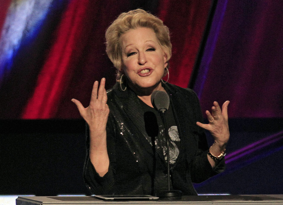 Photo -   FILE - In this April 14, 2012 file photo, Bette Midler introduces the late Laura Nyro for induction into the Rock and Roll Hall of Fame in Cleveland. An online campaign to raise money so Native American tribes in South Dakota can purchase land they consider sacred has gained steam with a growing list of celebrities backing the effort. P Diddy and Midler have tweeted their support for the effort to purchase nearly 2,000 acres in the Black Hills of South Dakota. They join actor Ezra Miller and hip-hop producer Sol Guy, who appeared in a recent video online with drawing attention to the effort. (AP Photo/Tony Dejak, File)