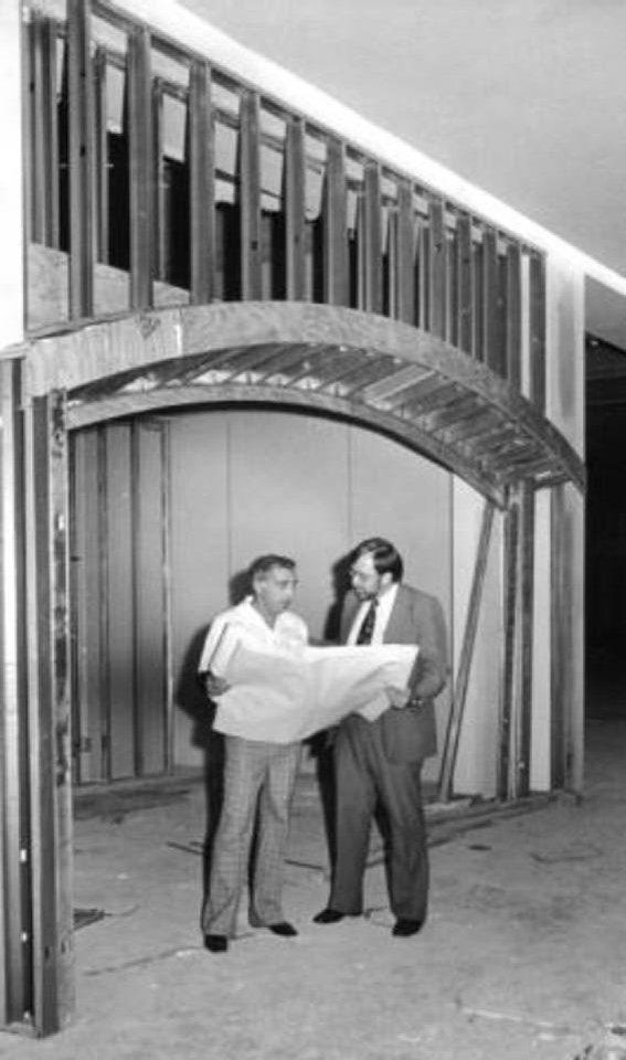 Photo - Mario Posillico, left, and Robert Lackmeyer, right, review plans for Century Center Mall inside a future storefront in this late 1970s photo.  Provided