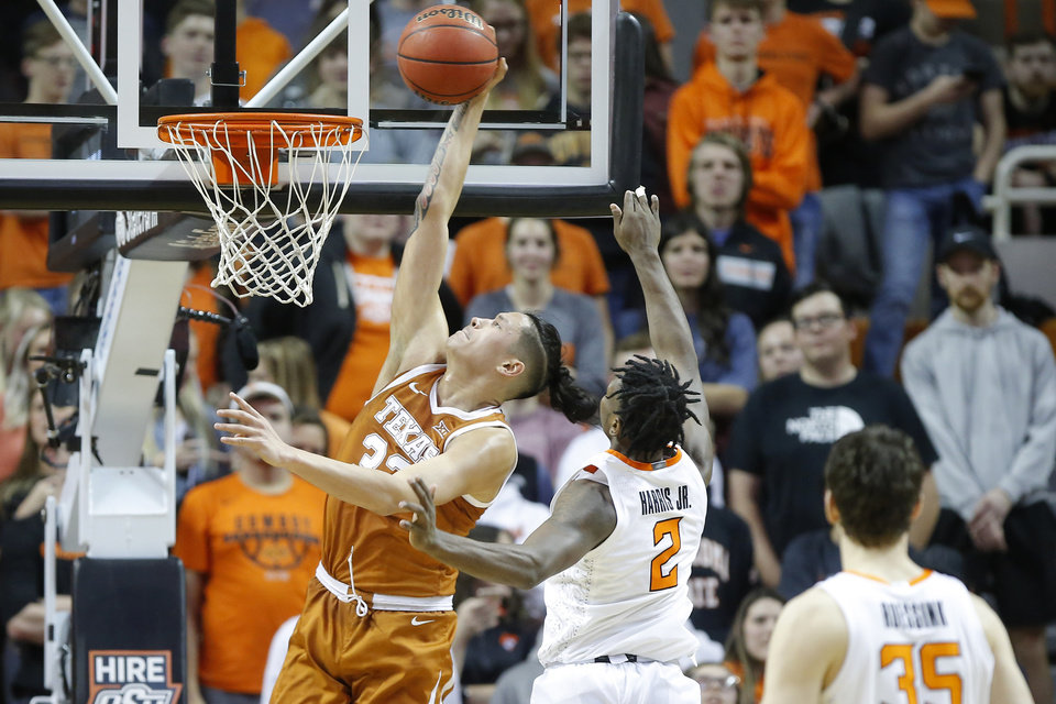 Photo - Texas' Kamaka Hepa (33) dunks the ball beside Oklahoma State's Chris Harris Jr. (2) during an NCAA basketball game between the Oklahoma State University Cowboys (OSU) and the Texas Longhorns at Gallagher-Iba Arena in Stillwater, Okla., Wednesday, Jan. 15, 2020. Oklahoma State lost 76-64. [Bryan Terry/The Oklahoman]