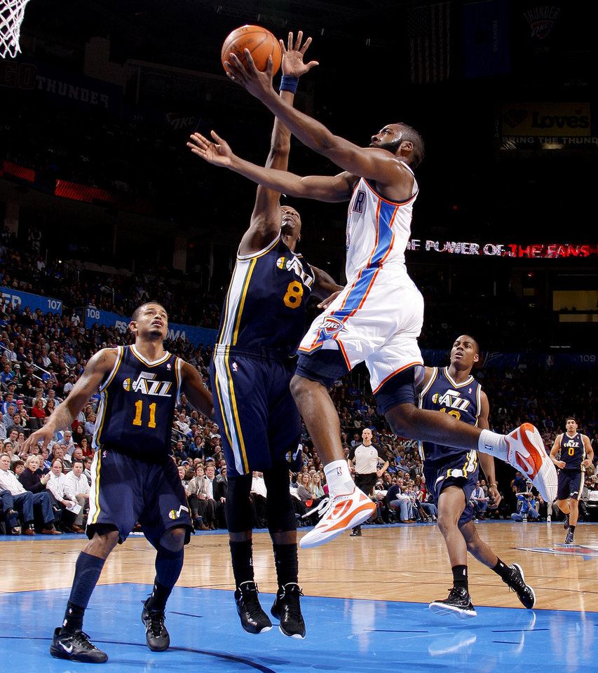 Photo - Oklahoma City's James Harden (13) goes by Utah's Earl Watson (11), Josh Howard (8), and Alec Burks (10) during an NBA game between the Oklahoma City Thunder and the Utah Jazz at Chesapeake Energy Arena in Oklahoma CIty, Tuesday, Feb. 14, 2012. Photo by Bryan Terry, The Oklahoman
