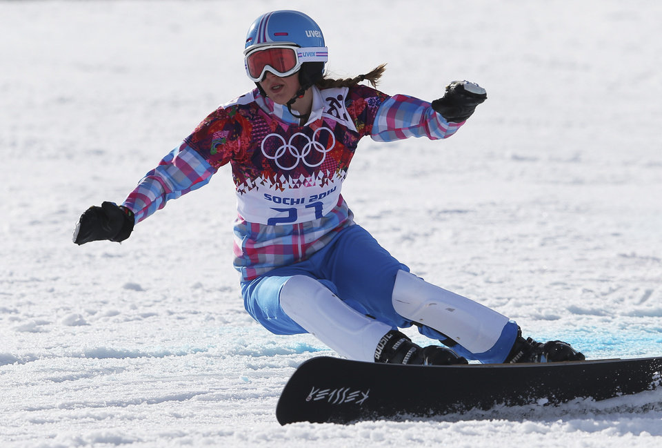 Photo - Russia's Alena Zavarzina competes in the small final to take the bronze medal in the women's snowboard parallel giant slalom at the Rosa Khutor Extreme Park, at the 2014 Winter Olympics, Wednesday, Feb. 19, 2014, in Krasnaya Polyana, Russia. (AP Photo/Sergei Grits)