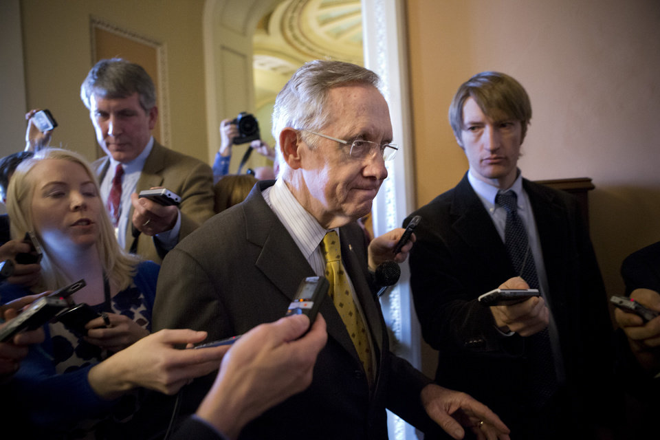 "Senate Majority Leader Harry Reid, D-Nev., walks to a closed-door meeting with fellow Democrats as he and Senate Minority Leader Mitch McConnell, R-Ky., work to negotiate a legislative path to avoid the so-called ""fiscal cliff,"" at the Capitol in Washington, Sunday, Dec. 30, 2012. Senate and House leaders are rushing to assemble a last-ditch agreement to stave off middle-class tax increases and possibly delay steep spending cuts in an urgent attempt to find common ground after weeks of gridlock. (AP Photo/J. Scott Applewhite)"