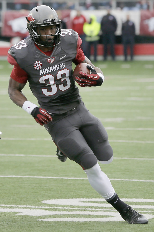 Photo - FILE - In this Nov. 23, 2013, file photo, Arkansas safety Korliss Marshall (33) carries in the first half of an NCAA college football game in Little Rock, Ark. Marshall will return to the Razorbacks in 2014. (AP Photo/Danny Johnston, File)