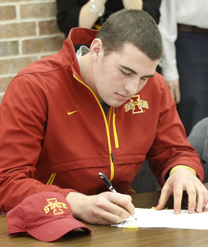 Putnam City North's Daniel Burton signs his letter of intent with Iowa State in Oklahoma City, Wednesday, February  1, 2012. Photo By Steve Gooch, The Oklahoman