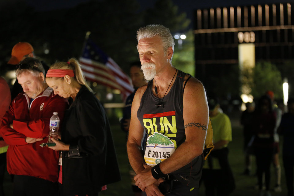 Photo - James Herlitz prays during the Sunrise Service before the Oklahoma City Marathon in Oklahoma City,  Sunday, April 29, 2018. Photo by Sarah Phipps, The Oklahoman01